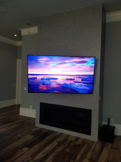 """77"""" OLED on stainless wall articulated out destin fl"""