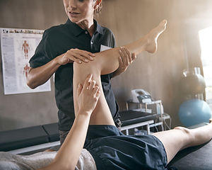 Personal trainer working with leg injury