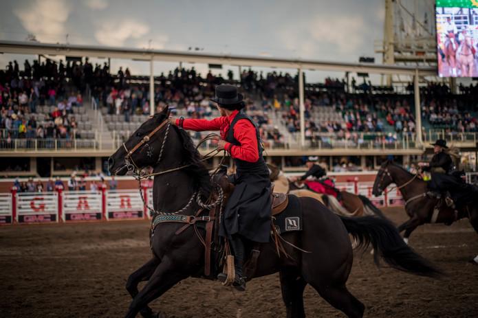 Jill Barron judging side saddle races at 2019 Calgary Stampede
