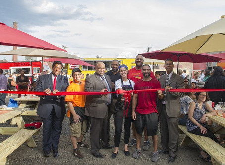 Crowd chows down at food truck park opening