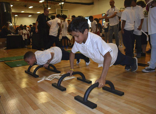 Bruins bring message of fitness, healthy living to Lawrence Boys and Girls Club