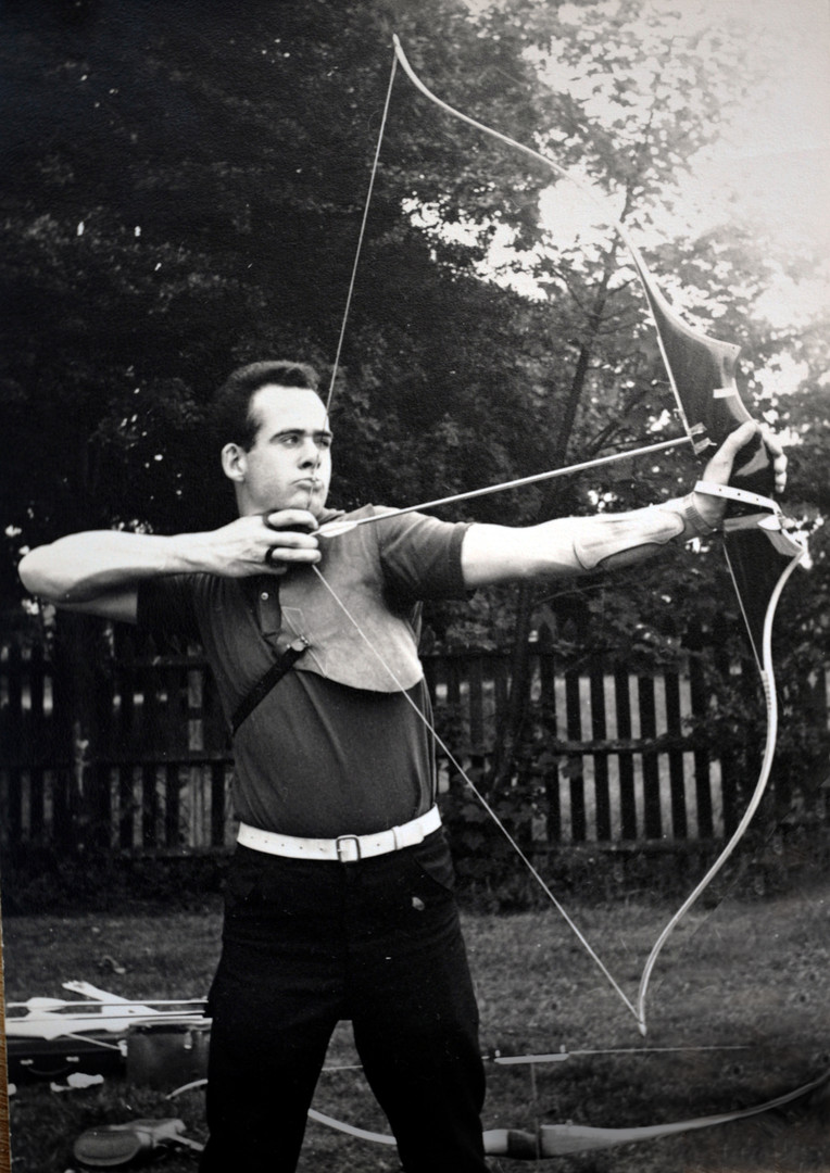 Mick with home made bow.jpg