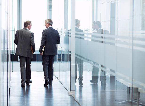 Businessmen in office hall All Seasons Insurance