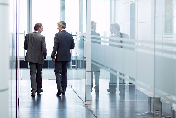 Two lawyers walking down hallway