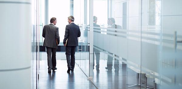Business Meeting of Two Men Walking in t