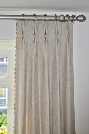 Pinch pleats with leading edge trim