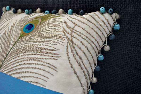 Cushion with bobble trim