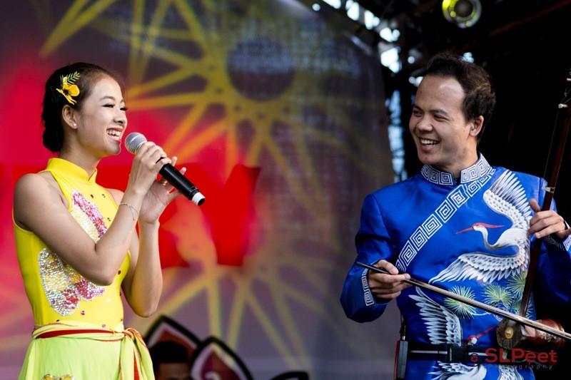 Dan Nhi player accompanying a Vietnamese folk singer accompanying vocalist