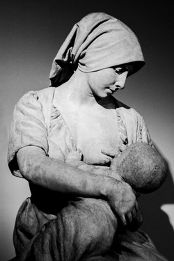 French Peasant Woman Nursing a Baby
