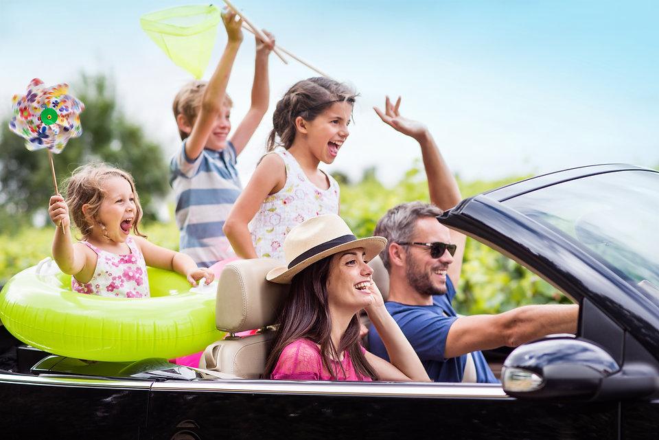 A joyful family, in a convertible car, g