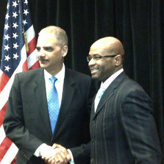 Robert with Eric Holder.jpg