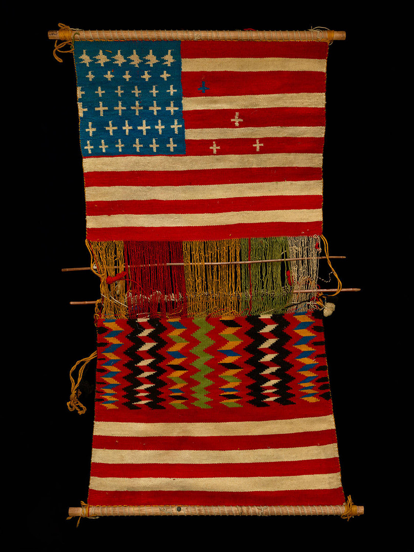 "Juanita (Asdzáá Tł'ogi), Diné (Navajo), Loom with Textile, 1874, wool yarn, wooden rods, 35.5"" × 17.8,"" Department of Anthropology, National Museum of Natural History, Smithsonian Institution, E16494-0."