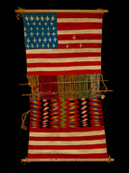 """Juanita (Asdzáá Tł'ogi), Diné (Navajo), Loom with Textile, 1874, wool yarn, wooden rods, 35.5"""" × 17.8,"""" Department of Anthropology, National Museum of Natural History, Smithsonian Institution, E16494-0."""