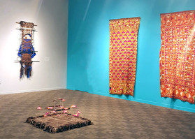 On the wall L-R: Horizon Lines - Embroidered Saloos (Dalip Kaur Bains, 1920s) On the floor: Smaller World After All - Small World After All