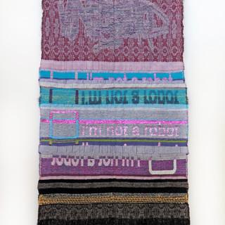 "CAPTCHA: Are You a Robot? 2017  Jacquard woven. Cotton, rayon, handspun wool, novelty yarn. 29"" x 63"""