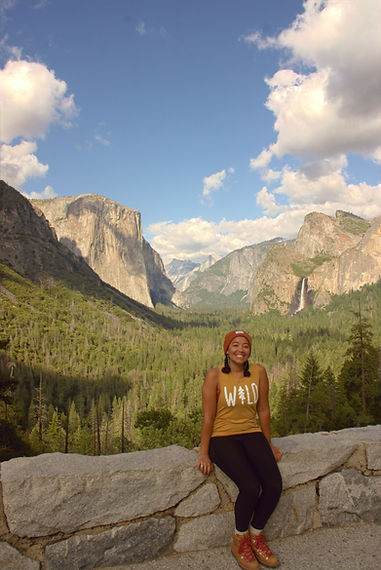 Woman sitting in from Yosemite National Park's iconic Tunnel View.