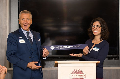 Toastmasters members confident and happy receiving award ribbon