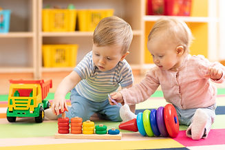 Preschool boy and girl playing on floor