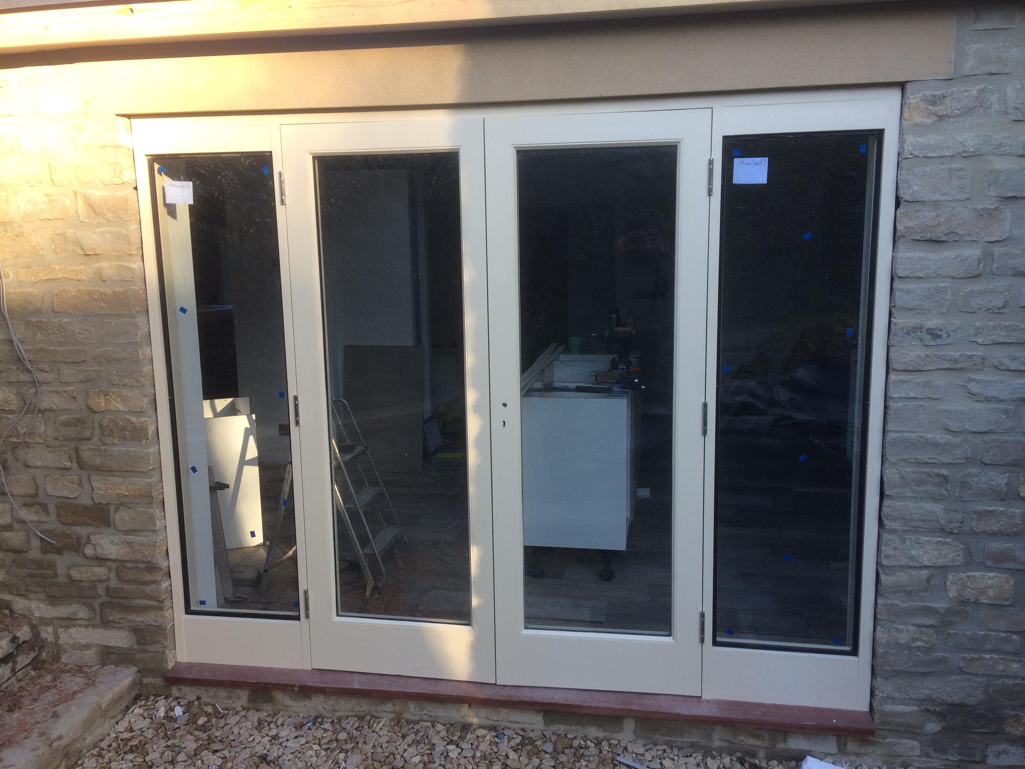 Hardwood French doors, side lights