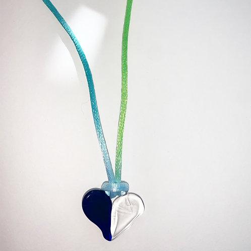 Blue half n half heart on blue/green satin