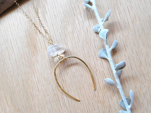 Gold crescent with quartz point necklace