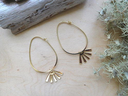 Gold hoops with sun charms earrings