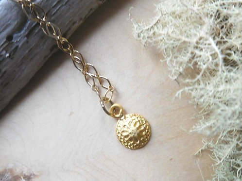 Gold flower charm necklace