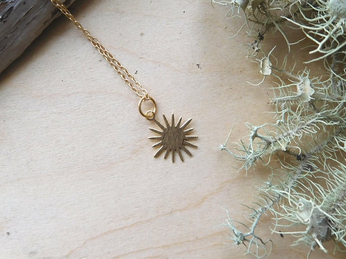 Tiny gold sun necklace