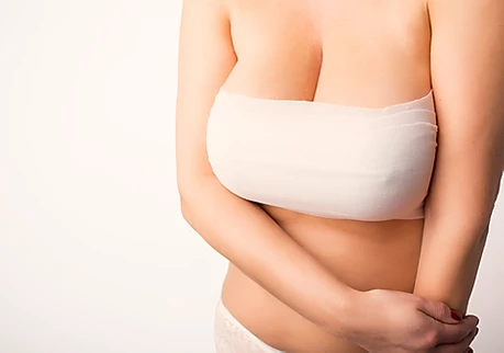 Thinking about a Breast Lift/Reduction? - Here's what you need to know.