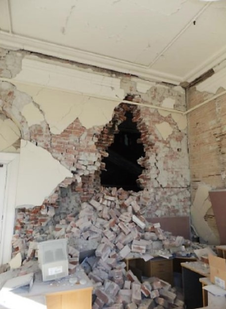 Collapse of fireplace and brick wall