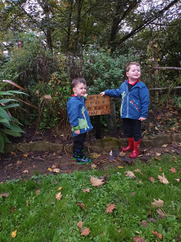 Tommy & Danny with their handcrafted sign made by Grandad John - Freckles Playschool, Lime