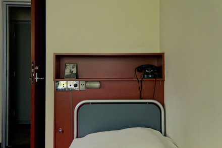 A photograph of a small part of a bedroom.