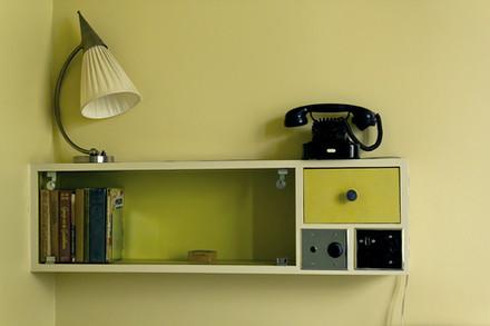 A photograph of a small shelf unit.