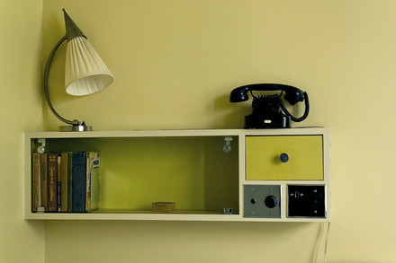 A photograph of a small shelf unit.