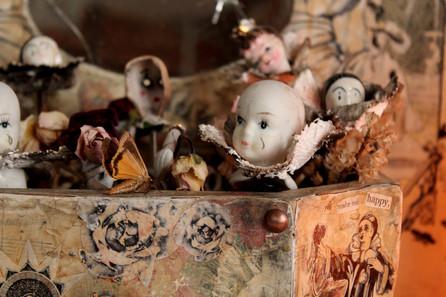 Pierrot head dolls and moth