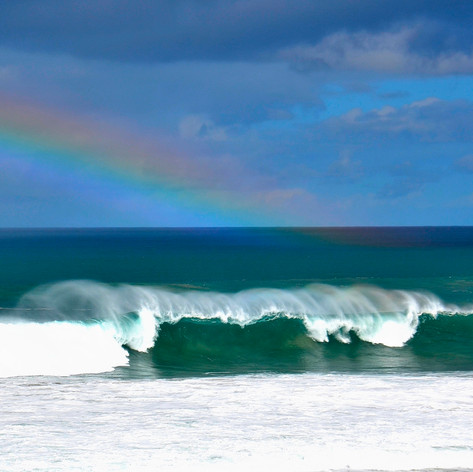 Clear sky with rainbow and wave