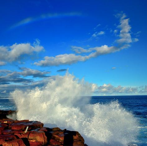 Crashing waves and rainbow