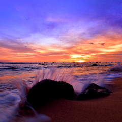 waves crashing sunset