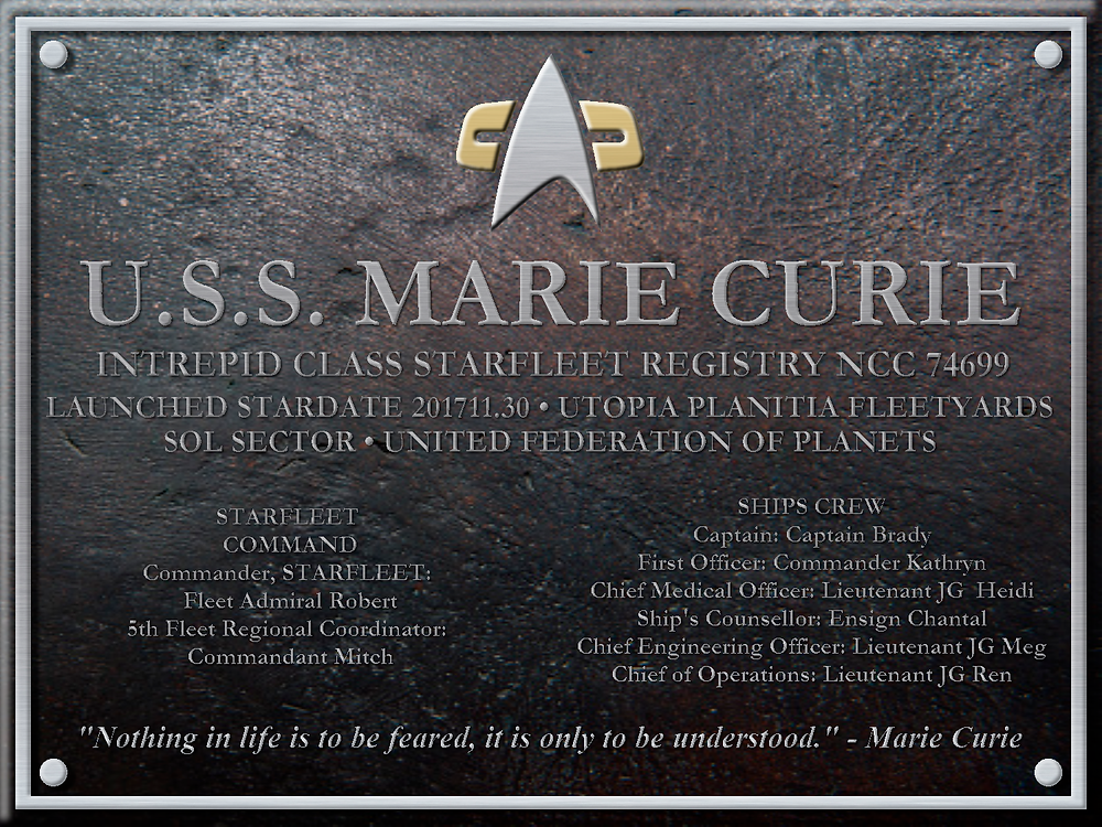 The dedication plaque of the USS Marie Curie, containing the ship's name, designation, and STARFLEET command/ships command officers (first names only), and the ship's motto at the bottom.