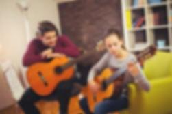 guitar-teacher-teaching.jpg
