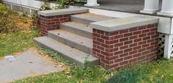 Brick buttresses with limestone cap ston