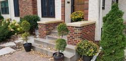 Brick buttresses with Kasota cap stones
