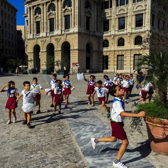 children running in uniforms