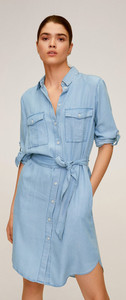 Woman wearing blue shirt dress