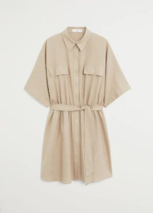 Woman wearing beige shirtdress
