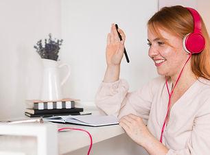 smiley-female-teacher-with-headphones-ho