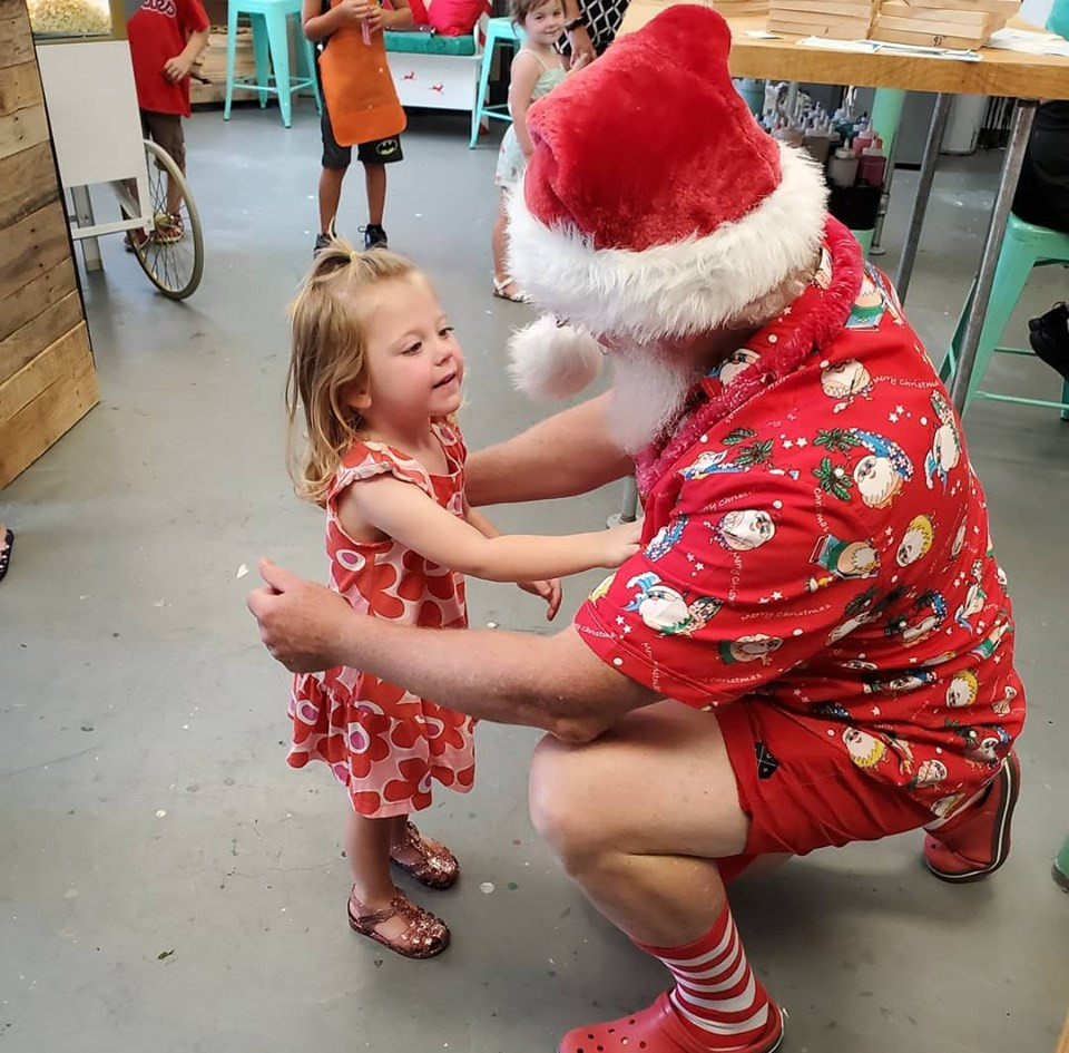 She couldn't get enough of Santa!