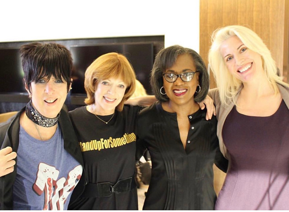 """We Believe Anita Hill."" Christopoulos (far right) with (left to right) Grammy, Emmy, and Golden Globe winning songwriter and hitmaker Diane Warren, actress Frances Fisher and Anita Hill, the woman who made history by sharing her #MeToo story on Capitol Hill in opposition to the nomination of Justice Clarence Thomas to the US Supreme Court."