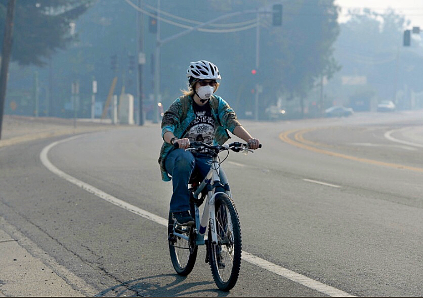 Poor air quality caused by Northern California wildfires force residents to don masks while outside.