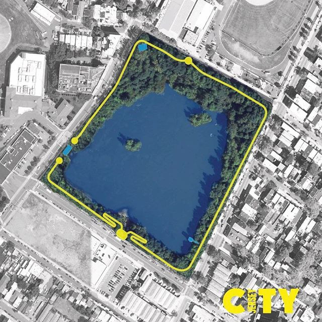A top-down view of Reservoir # 3. The photo is black and white except for the Reservoir, which is colorized blue and green. There is a drawing in yellow of the mapped trails and the City of Jersey City logo in yellow in the bottom right corner